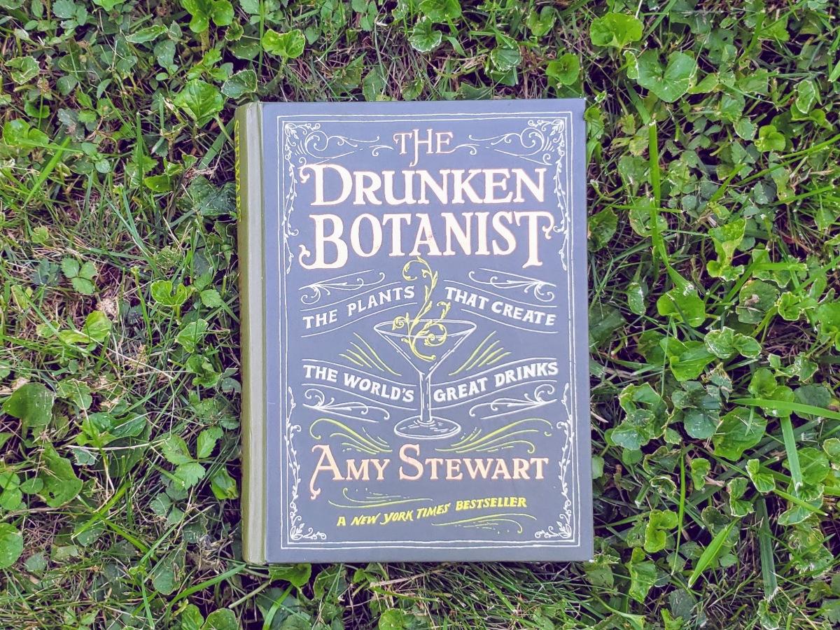 The Drunken Botanist by Amy Stewart book in grass