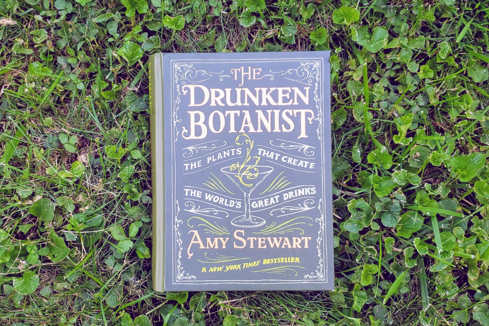 The Drunken Botanist by Amy Stewart book in grass